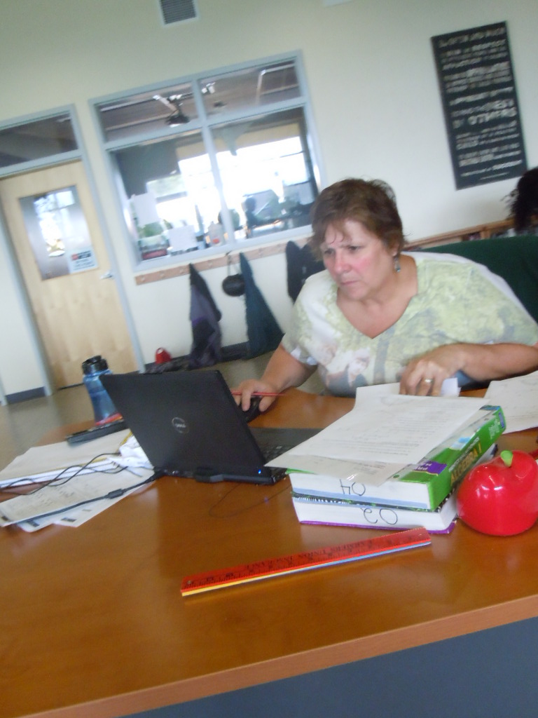 Photo by Thomas Ruppert: Gloria Hanson works at her desk. iTalc could be a tool used by all teachers.