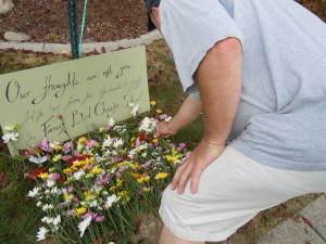 Loving thoughts... Todd honoring the late Birds with flowers students gave.
