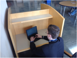 An FBCS student working in an assembled cubicle.Photo by: Harrison Hertzberg