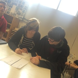 Activites... Junior student Ericka Moore attempts to teach Jack Meier how to draw... unsuccessfully.