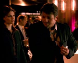 Autograph?... Richard Castle, Nathan Fillion, reaches for a pen for what he thinks is a potential autograph while Kate Beckett, Stana Katic, prepares to detain Castle for questioning. This is the first introduction of the Beckett and Castle characters which lead to 8 seasons.
