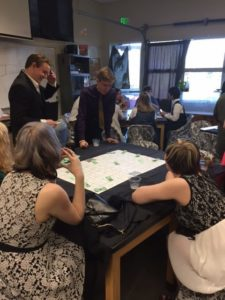 High Rollers….Several students try their hand at biribi, a classic Italian game. Photo-by: Mary Jensen