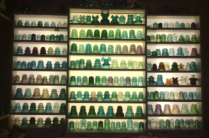 This is my collection of glass insulators. I have gathered around 600 them in my three years of collecting. Although this image shows many colors and styles of glass insulators, it is only a small fraction of all the colors and varieties. Photo by Travis Tuttle