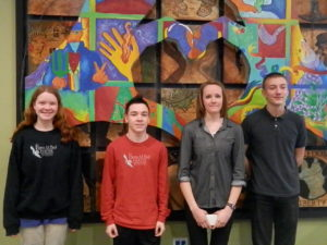 Students of Integrity… Four out of the five students of the month are seen next to the iconic FBCS mural. Photo by Rey Frank.