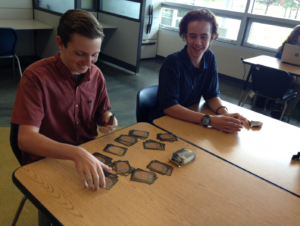 New Students and Magic… Freshman Reese Litster and his friend Ben play Magic in study lab.