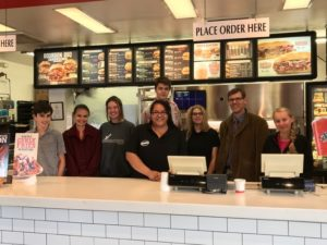 Friendly Service… Lolisa and the Journalism staff stand behind the counter at Arby's.