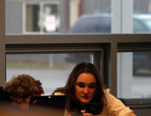 A Secret Addition… Many students can be secretly on their phones in class. Photo by: Kai Eagley