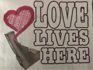 Love lives here... Posters have popped up around town to counter racist rhetoric