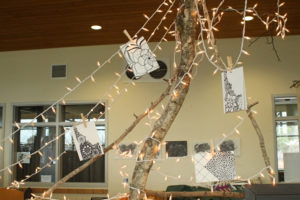 Hang in there… Some of a students designs for the craft fair hanging from a tree